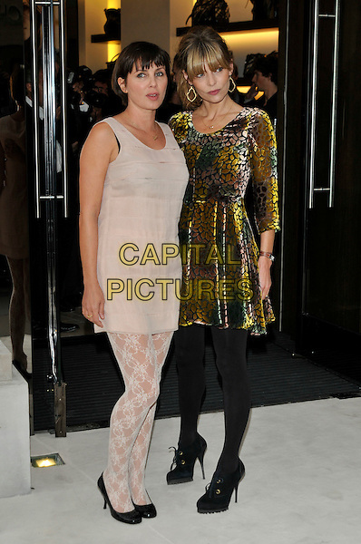 SADIE FROST & JEMIMA FRENCH.Fashion's Night Out: Vogue & Burberry Cocktail Party, London, England..September 10th, 2009 .full length beige sleeveless dress top lace tights pattern black pumps shoes flats gold velvet purple green heels .CAP/PL.©Phil Loftus/Capital Pictures.