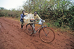 Men With Bicycle In Mud