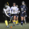 Massapequa No. 2 Jennifer Cooney, left, moves the ball downfield during the Nassau County varsity field hockey Class A final against Baldwin at Adelphi University on Saturday, October 31, 2015. She scored a goal late in the first half to give the Chiefs a 1-0 lead. Massapequa extended its lead to 2-0 in the second half and held on to win 2-1.<br /> <br /> James Escher<br /> <br /> James Escher