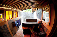 Inside the Happy House at the Pondok Pitaya Surfer Hotel with one of the open air showers and bathrooms.
