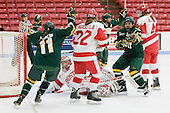 Emily Walsh (Vermont - 11) and Peggy Wakeham (Vermont - 14) celebrate. - The Boston University Terriers tied the visiting University of Vermont Catamounts 2-2 on Saturday, November 13, 2010, at Walter Brown Arena in Boston, Massachusetts.