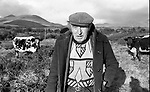 Direendraugh, Blackwater, Sneem, County Kerry Ireland 1992:   Farmer Jerome O'Leary poses with his cow known as  'Big Bertha', a 48 years old Droimeann cow who appeared in the Guinness Book of Records as the world's oldest cow. In this photograph she was pregnant with her record breaking 39 calf born soon afterwards.<br /> Big Bertha died on New Year's Eve 1993.<br /> Photo: Don MacMonagle <br /> e: info@macmonagle.com