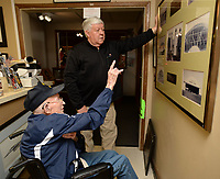 NWA Democrat-Gazette/ANDY SHUPE<br /> Frank Brooks of Fayetteville (left) refers to historic photographs Friday, March 22, 2019, as he speaks with friend Steve Rust of Farmington at the Arkansas Air and Military Museum about his work to help construct the White Hangar at the Fayetteville Municipal Airport in 1943 before he enlisted in the U.S. Navy. The hangar was designed during World War II as a city project in support of the war effort. Brooks, 94, presented the museum with a series of photographs to commemorate the building of the hangar, which now serves as the museum's home.