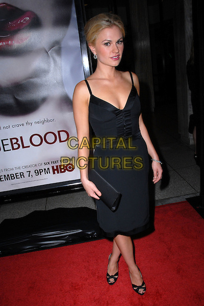 ANNA PAQUIN .True Blood premiere held at the Cinerama Dome, Hollywood, California, USA, 04 September 2008..full length black dress clutch bag shoes open toe .CAP/ADM/FS.©Faye Sadou/Admedia/Capital Pictures