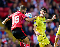 Lincoln City's Jorge Grant battles with Fleetwood Town's Ched Evans<br /> <br /> Photographer Andrew Vaughan/CameraSport<br /> <br /> The EFL Sky Bet League One - Lincoln City v Fleetwood Town - Saturday 31st August 2019 - Sincil Bank - Lincoln<br /> <br /> World Copyright © 2019 CameraSport. All rights reserved. 43 Linden Ave. Countesthorpe. Leicester. England. LE8 5PG - Tel: +44 (0) 116 277 4147 - admin@camerasport.com - www.camerasport.com