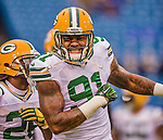 14 December 2014: Green Bay Packers linebacker Jay Elliott warms up prior to facing the Buffalo Bills at Ralph Wilson Stadium in Orchard Park, NY. The Bills defeated the Packers 21-13, snapping the Packers' 5-game winning streak and keeping the Bills' 2014 playoff hopes alive. Mandatory Credit: Ed Wolfstein Photo *** RAW (NEF) Image File Available ***