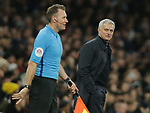 Tottenham's Head Coach Jose Mourinho shares a laugh with assistant referee, Scott Ledger during the Premier League match at the Tottenham Hotspur Stadium, London. Picture date: 30th November 2019. Picture credit should read: Paul Terry/Sportimage