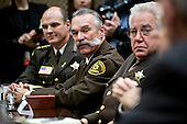 Richard Stanek, sheriff from Hennepin County, Minnesota, from left, Danny Glick, sheriff from Laramie County, Wyoming, and John Layton, sheriff from Marion County, Indiana, listen during a listening session with U.S. President Donald Trump, not pictured, in the Roosevelt Room of the White House in Washington, D.C., U.S., on Tuesday, Feb. 7, 2017. The Trump administration will return to court Tuesday to argue it has broad authority over national security and to demand reinstatement of a travel ban on seven Muslim-majority countries that stranded refugees, triggered protests and handed the young government its first crucial test. <br /> Credit: Andrew Harrer / Pool via CNP