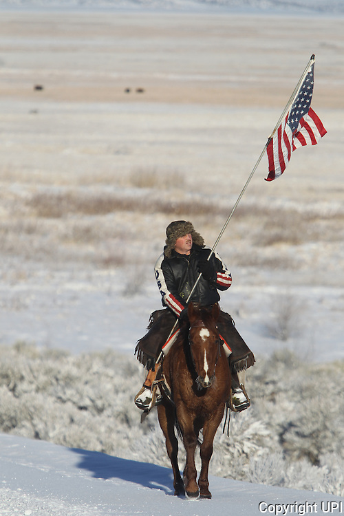 Duane Ehmer, of Irrigon, Oregon, rides the perimeter on Hellboy, at the Malheur National Wildlife Reserve on January 15, 2016 in Burns, Oregon. Ehmer has been pulling sentry duty during the takeover. Ammon Bundy and about 20 other protesters took over the refuge on Jan. 2 after a rally to support the imprisoned local ranchers Dwight Hammond Jr., and his son, Steven Hammond.      Photo by Jim Bryant/UPI