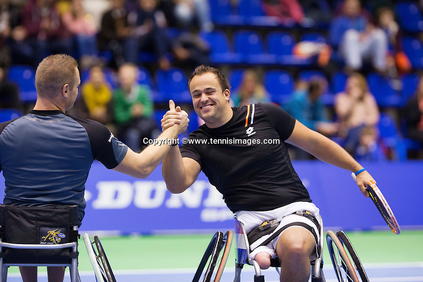 December 20, 2014, Rotterdam, Topsport Centrum, Lotto NK Tennis, Mens doubles wheelchair final winners Tom Egberink (R) with his partner Maikel Scheffers celebrate<br /> Photo: Tennisimages/Henk Koster