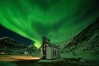 Northern Lights - Aurora Borealis fill sky over Vik cemetery, Vestvågøy, Lofoten Islands, Norway