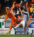 Liam Kelly fouls Gary Mackay-Steven in the box for a penalty kick to Dundee Utd and a red card for the Kilmarnock player