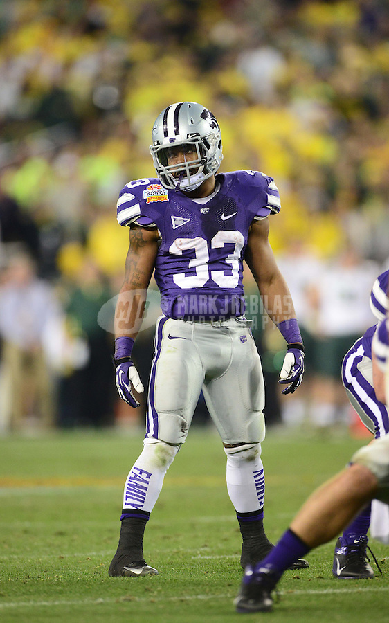 Jan. 3, 2013; Glendale, AZ, USA: Kansas State Wildcats running back John Hubert (33) against the Oregon Ducks during the 2013 Fiesta Bowl at University of Phoenix Stadium. Oregon defeated Kansas State 35-17. Mandatory Credit: Mark J. Rebilas-