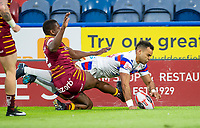 Picture by Allan McKenzie/SWpix.com - 11/05/2018 - Rugby League - Ladbrokes Challenge Cup - Huddersfield Giants v Wakefield Trinity - John Smith's Stadium, Huddersfield, England - Huddersfield's Jermaine McGillvary can't prevent Wakefield's Mason Caton-Brown scoring a try.