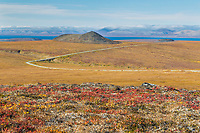 The Teller Highway arcs across the tundra on the Seward Peninsula. It connects the village of Teller to Nome. The village of Brevig Mission and Port Clarence are visible in the distance.