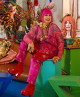 Portrait of Zandra Rhodes dressed head to toe in pink to match her hair