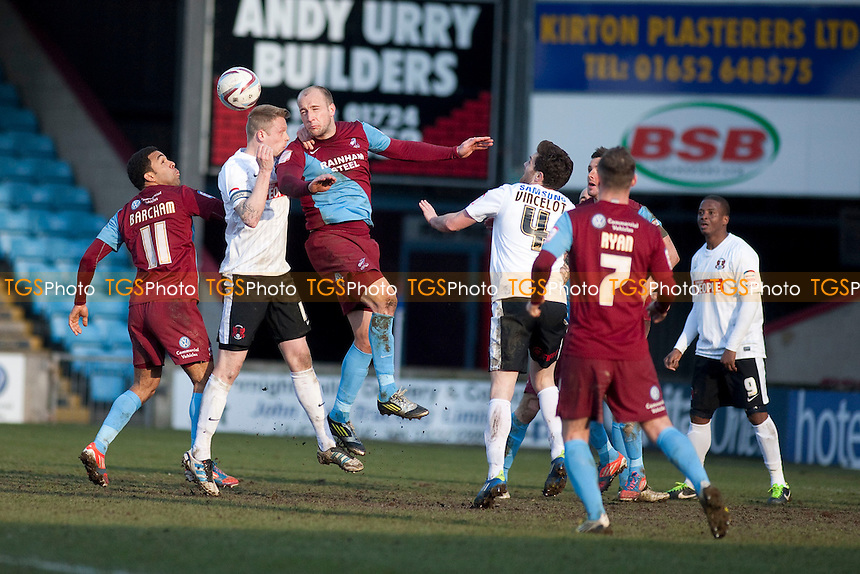 Andy Barcham (Scunthorpe Utd) and Tom Newey (Scunthorpe Utd) clear. - Scunthorpe United vs Leyton Orient - NPower League One Football at Glanford Park - 29/03/13 - MANDATORY CREDIT: Mark Hodsman/TGSPHOTO - Self billing applies where appropriate - 0845 094 6026 - contact@tgsphoto.co.uk - NO UNPAID USE.