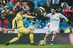 Isco Alarcon (R) of Real Madrid is tackled by Manuel Trigueros Munoz of Villarreal CF during the La Liga 2017-18 match between Real Madrid and Villarreal CF at Santiago Bernabeu Stadium on January 13 2018 in Madrid, Spain. Photo by Diego Gonzalez / Power Sport Images