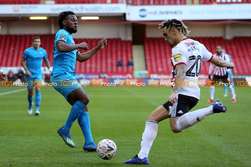 Shaquile Coulthirst of Barnet and Kean Bryan of Sheffield United during Sheffield United vs Barnet, Emirates FA Cup Football at Bramall Lane on 6th January 2019