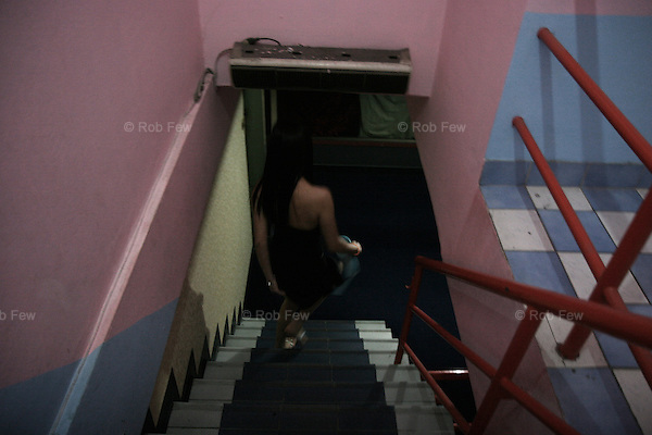After her second client of the night, Fon walks downstairs - back to the fish bowl from where, like Nam back in her bar in Pattaya, she hopes one day to escape. <br />