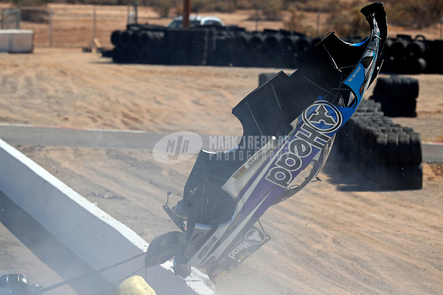 Feb 25, 2018; Chandler, AZ, USA; The body from the car of NHRA funny car driver Jonnie Lindberg flies through the air as he crashes with John Force during the Arizona Nationals at Wild Horse Pass Motorsports Park. Mandatory Credit: Mark J. Rebilas-USA TODAY Sports