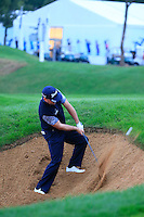 Graeme McDowell (NIR) chips from a bunker at the 18th green during Wednesday's Pro-Am Day of the 2014 BMW Masters held at Lake Malaren, Shanghai, China 29th October 2014.<br /> Picture: Eoin Clarke www.golffile.ie
