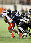 First Coast Buccaneers defensive lineman Seyvon Lowry #44 tackles  Leon Allen #7 during the second quarter of the Florida High School Athletic Association 7A Championship Game at Florida's Citrus Bowl on December 16, 2011 in Orlando, Florida.  The score at halftime is Manatee 17 - First Coast 0.  (Photo By Mike Janes Photography)