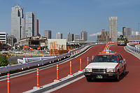 A taxi  on a road overlooking the site of the old Tsukiji Wholesale fish market which is being demolished. Tokyo, Japan. Thursday May 30th 2019 The famous fish market, the largest in the world, relocated to Toyosu in October 2018. The former site is almost completely demolished now and will be redeveloped in time for the  Tokyo 2020 Olympics Games.