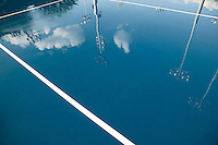 Flushing, NY - 17 August 2005 - Clouds and lights reflect in the water poured onto a court on which staff will practice  court drying techniques at the National Tennis Center - home of the US Open - in Flushing, Queens, NY, USA, 17 August 2005.