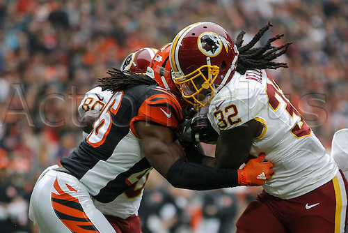 30.10.2016. Wembley Stadium, London, England. NFL International Series. Cincinnati Bengals versus Washington Redskins. Washington Redskins running back Silas Redd (32) is tackled by Cincinnati Bengals cornerback Josh Shaw (26).  Final score: Washington Redskins 27-27 Cincinnati Bengals after overtime.