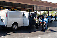 AJ ALEXANDER/AAP IMAGE by AJ ALEXANDER - EXPRESS CAR WASH RAID FOR ILLEGAL IMMIGRANTS IN NORTH SCOTTSDALE, AZ FOR USING FALSE ID'S FOR WORKING WERE PICKED UP BY ICE.<br /> PHOTO BY AJ ALEXANDER