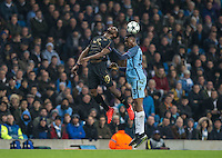 Moussa Dembele of Celtic and Tosin Adarabioyo of Manchester City go up for the ball during the UEFA Champions League GROUP match between Manchester City and Celtic at the Etihad Stadium, Manchester, England on 6 December 2016. Photo by Andy Rowland.