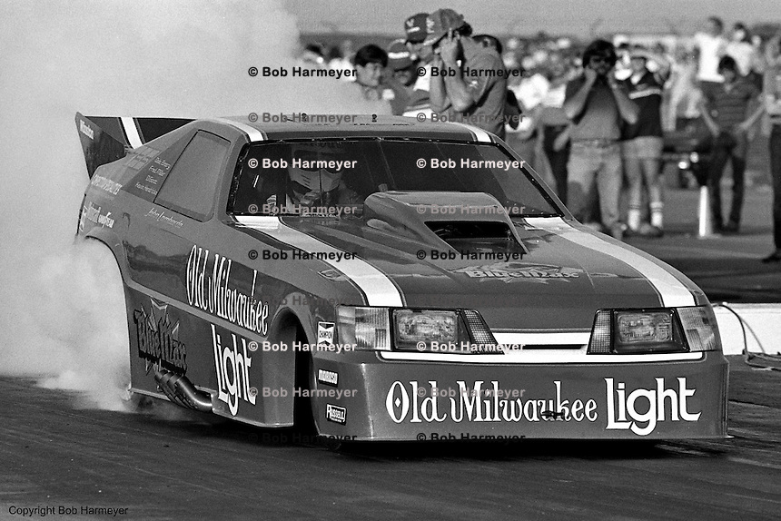 POMONA, CALIFORNIA: John Lombardo drives the Raymond Beadle Blue Max Funny Car during a 1985 NHRA drag race at Pomona, California.
