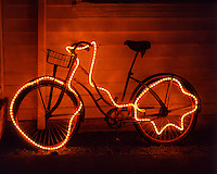 Old bicycle decorated with holiday lights in Clatsop County, Oregon