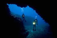 Divers (MR) pictured at an opening to First Cathedral off the Island of Lanai, Hawaii.