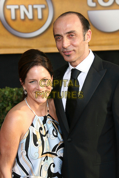 SHAUN TOUB & GUEST.12th Annual Screen Actors Guild Awards (SAG) held at the Shrine Auditorium, Los Angeles, California, USA..January 29th, 2006.Photo: Zach Lipp/AdMedia/Capital Pictures.Ref: ZL/ADM.half length black halterneck.ww.capitalpictures.com.sales@capitalpictures.com.© Capital Pictures.