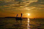 FLY FISHING SILHOUETTE ON CASCO BAY IN MAINE
