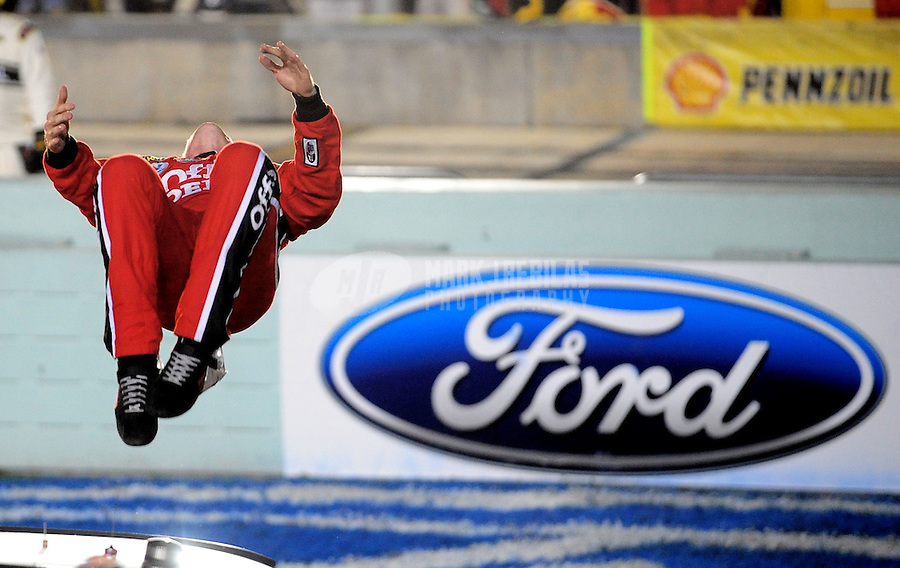 Nov. 16, 2008; Homestead, FL, USA; NASCAR Sprint Cup Series driver Carl Edwards celebrates after winning the Ford 400 at Homestead Miami Speedway. Mandatory Credit: Mark J. Rebilas-