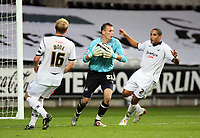 Pictured: Artur Krysiak (C) , goalkeeper for Swansea replacing Dorus de Vries, surrounded by team mates Garry Monk (L) and Ashley Williams (R).<br />