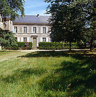 The rear facade of the predominantly 18th century chateau viewed from the surrounding parkland