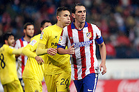 Godin of Atletico de Madrid and Gabriel of Villarreal during La Liga match between Atletico de Madrid and Villarreal at Vicente Calderon stadium in Madrid, Spain. December 14, 2014. (ALTERPHOTOS/Caro Marin) /NortePhoto