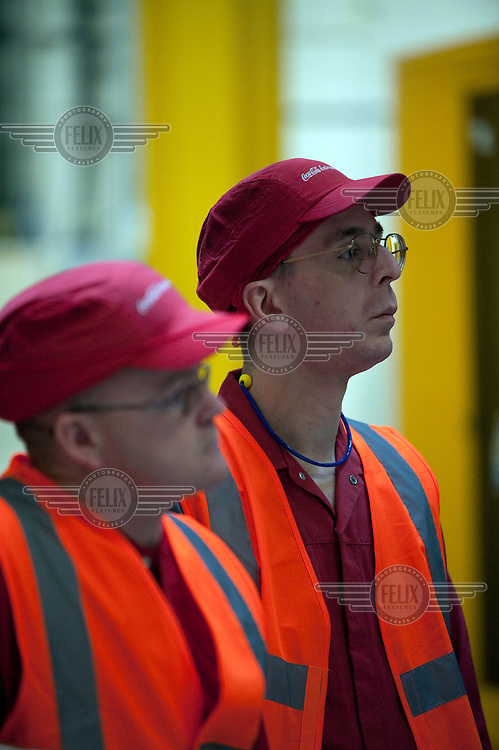 Workers at a Coca Cola factory in Wakefield wait for Conservative Party leader David Cameron to give a speech on the campaign trail.