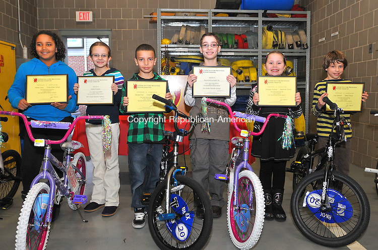 NAUGATUCK,  CT, 01 FRERUARY 2012-020112JS18-Naugatuck school student were awarded bikes and helmets for winning the annual Naugatuck Fire Department's fire safety poster contest on Wednesday. The winner are, from left, fifth grade-second place Kimani Grey (Cross Street Intermediate School); fourth grade-first place Hailey Russell (Western School); fifth grade-third place George Cruz (Cross Street Intermediate School; fifth grade-first place Raymond Lucarelli (Hillside Intermediate School); fourth grade-second place Michaela Turecek (Maple Hill School) and fourth grade-third place Trey Generali (Salem School). Both first place winners will compete on a regional level against entries from other towns in New Haven County. The bikes were donated through a grant from Walmart. .Jim Shannon Republican-American