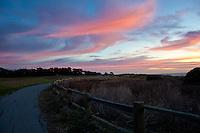 A wooden fence and the path at sunset - Bluff Top Coastal Park, Half Moon Bay, California.