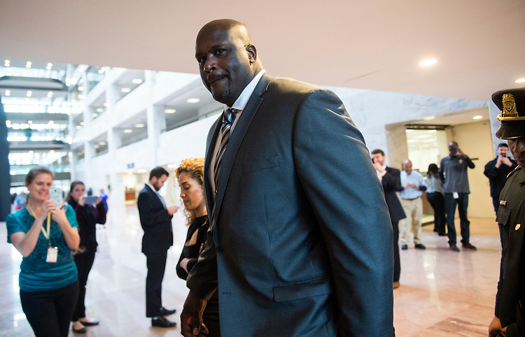 "UNITED STATES - NOVEMBER 30: Shaquille O'Neal arrives in the Hart Senate Office Building on Wednesday, Nov. 30, 2016. Shaq was on Capitol Hill to host the ""Recognizing Law Enforcement's Critical Role in the Fight Against Impaired Driving"" briefing with Responsibility.org. (Photo By Bill Clark/CQ Roll Call)"