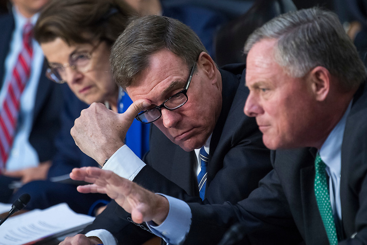 """UNITED STATES - AUGUST 01: Chairman Richard Burr, R-N.C., right, and Vice Chairman Mark Warner, D-Va., conduct a Senate (Select) Intelligence Committee hearing in Hart Building titled """"Foreign Influence on Social Media Platforms: Perspectives from Third-Party Social Media Experts,"""" on August 1, 2018. (Photo By Tom Williams/CQ Roll Call)"""