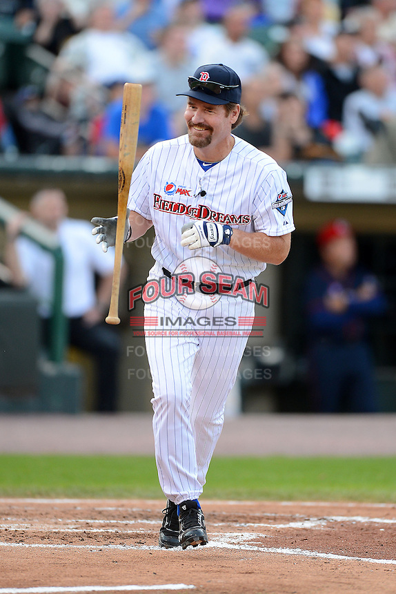 Hall of Fame third baseman Wade Boggs #12 flips his bat reacting to a pop up during the MLB Pepsi Max Field of Dreams game on May 18, 2013 at Frontier Field in Rochester, New York.  (Mike Janes/Four Seam Images)