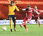 Adam Forshaw of Middlesbrough strikes the ball past Dominic Lorfa of Wolverhampton Wanderers towards goal - Sky Bet Championship - Middlesbrough vs Wolverhampton Wanderers - Riverside Stadium - Middlesbrough - England - 4th of March 2016 - Picture Jamie Tyerman/Sportimage