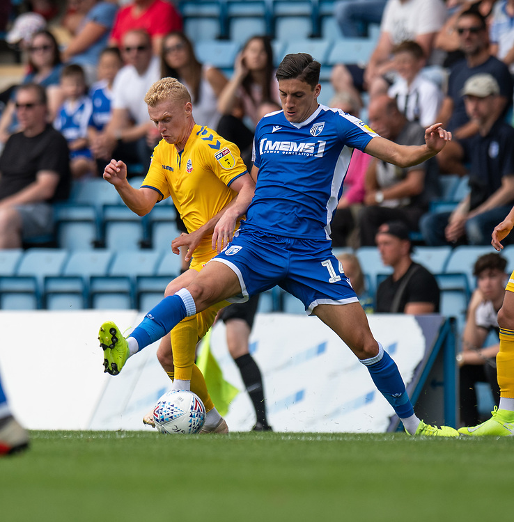Gillingham's Alfie Jones (right) battles for possession with Bolton Wanderers' James Weir (left) <br /> <br /> Photographer David Horton/CameraSport<br /> <br /> The EFL Sky Bet League One - Gillingham v Bolton Wanderers - Saturday 31st August 2019 - Priestfield Stadium - Gillingham<br /> <br /> World Copyright © 2019 CameraSport. All rights reserved. 43 Linden Ave. Countesthorpe. Leicester. England. LE8 5PG - Tel: +44 (0) 116 277 4147 - admin@camerasport.com - www.camerasport.com