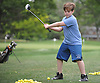 Alex Tundidor, 11, of Cedarhurst practices his golf swing at the driving range of Lawrence Yacht and Country Club on Tuesday, June 7, 2016.